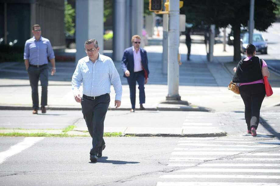 Pedestrians cross at the intersection of Tresser Boulevard and Atlantic Street, in downtown Stamford, Conn., on Tuesday, July 10, 2018. Photo: Michael Cummo / Hearst Connecticut Media / Stamford Advocate