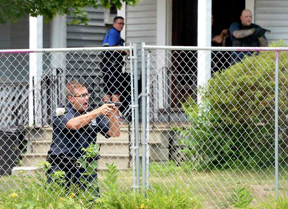 Police with weapons drawn outside 1373 Union Street following the report of a shooting Tuesday July 10, 2018 in Schenectady, NY. (John Carl D'Annibale/Times Union)