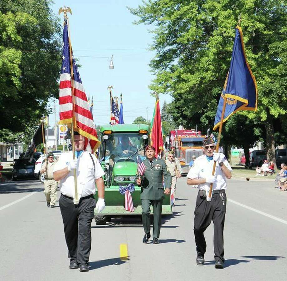 Veterans lead Saturday's Freedom Festival Parade in downtown Cass City. For more photos from this festival, see Page 7A. (Bradley Massman/Huron Daily Tribune)
