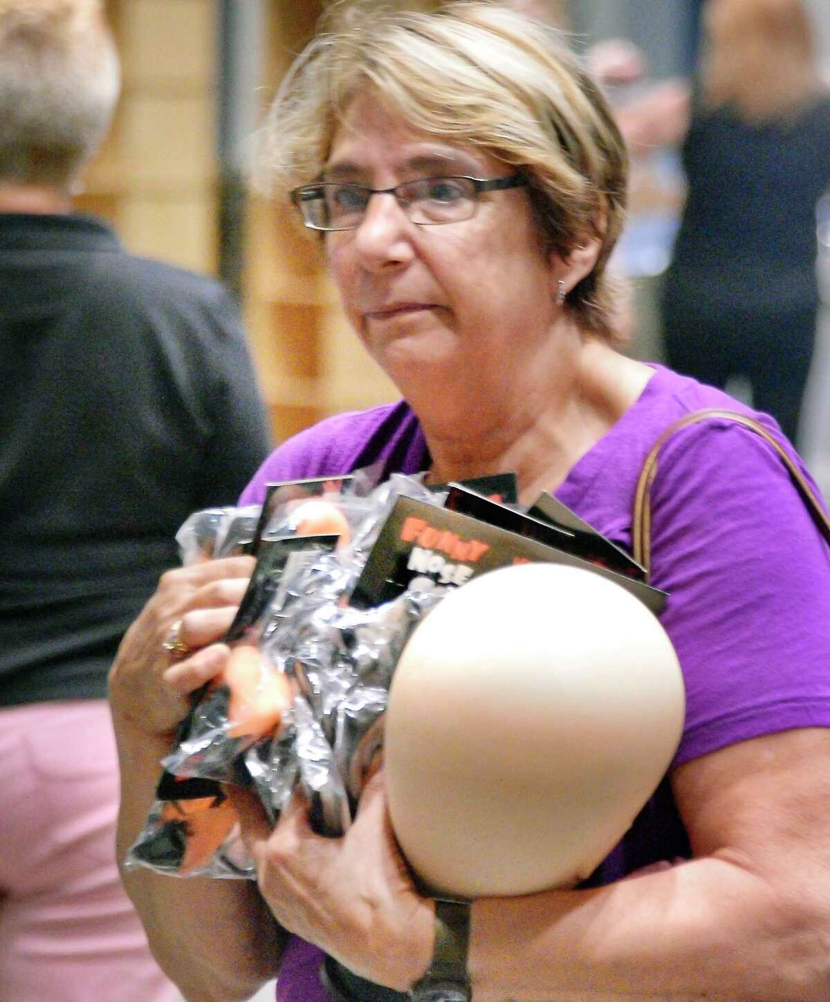 Janet Helstowski of Niskayuna has her hands full during the Proctors Clearance Sale in Key Hall Tuesday July 10, 2018 in Schenectady, NY. (John Carl D'Annibale/Times Union)