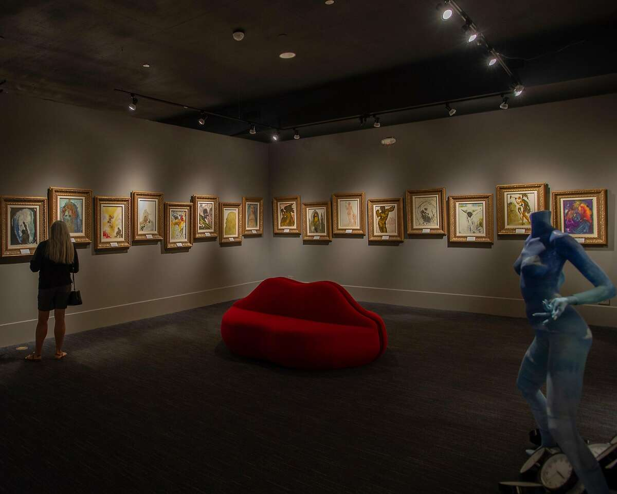 A woman walks through the Dali17 museum in Monterey, Calif. on July 10, 2018.