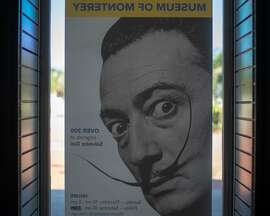 Postr of Dali in window of Dali17 Museum in Monterey