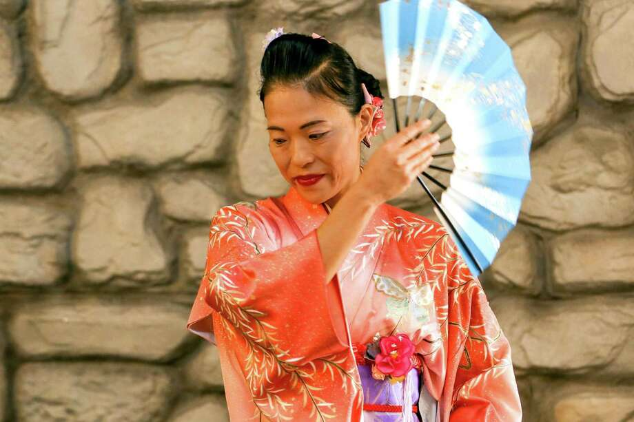 Risa Tallent performs a traditional Japanese dance during the Tanabata celebration on Tuesday, July 10, 2018, at The Woodlands Children's Museum. Tanabata is a Japanese festival, also known as the Star Festival, that celebrates the meeting of the deities Orihime and Hikoboshi. Photo: Michael Minasi, Staff Photographer / Houston Chronicle / © 2018 Houston Chronicle