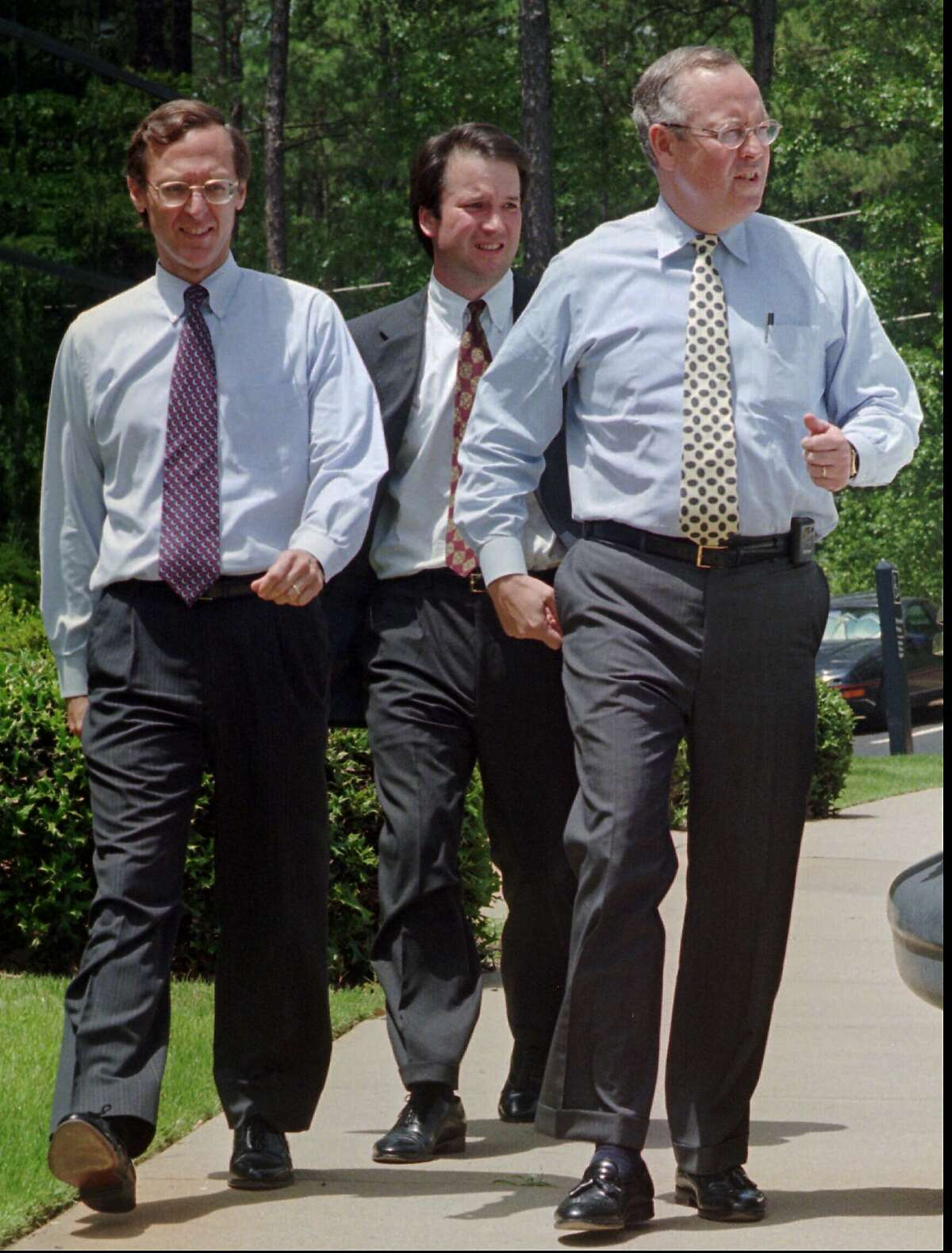 Whitewater prosecutor Kenneth Starr, right, walks with deputy independent council, John Bates, left, and associate independent council, Brett Kavanaugh on Monday, June 23, 1997, in Little Rock, Ark. In a victory for Whitewater prosectors, the Supreme Court, Monday, rejected White House efforts to withold notes that lawyers took of their conversations with Hillary Rodham Clinton. (AP Photo/Mike Wintroath)