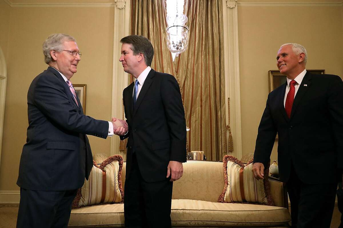 Brett Kavanaugh, U.S. Supreme Court associate justice nominee for U.S. President Donald Trump, center, shakes hands with Senate Majority Leader Mitch McConnell, a Republican from Kentucky, during a meeting with U.S. Vice President Mike Pence, right, at the U.S. Capitol in Washington, D.C., U.S., on Tuesday, July 10, 2018. Senate Republicans are pledging a swift confirmation process that would put Kavanaugh on the bench before the new term opens Oct. 1, and there is little Democrats can do to stop them. Photographer: Chip Somodevilla/Pool via Bloomberg
