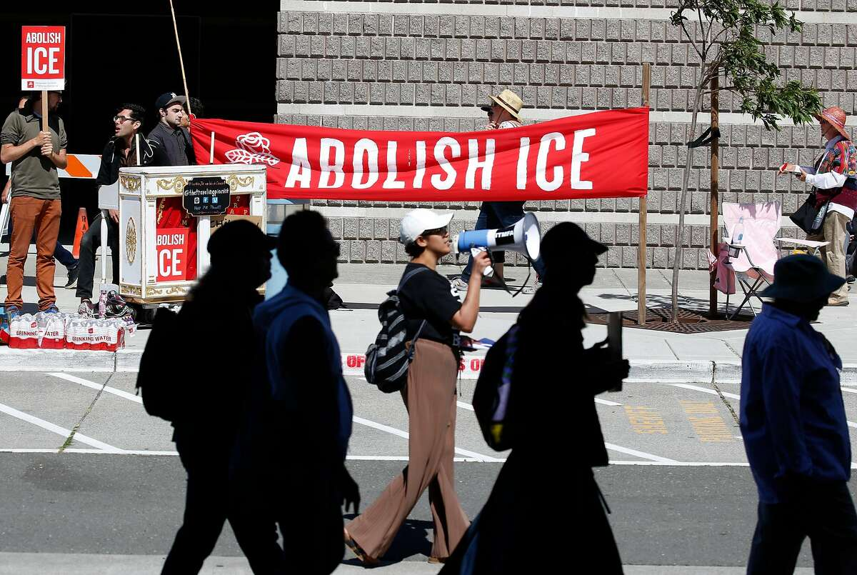 Immigrants rights protesters march in front of the West County Detention Facility in Contra Costa County in Richmond, California on Tuesday, June 26, 2018. Demonstrators say ICE authorities are detaining as many as 200 immigrants daily at the facility.