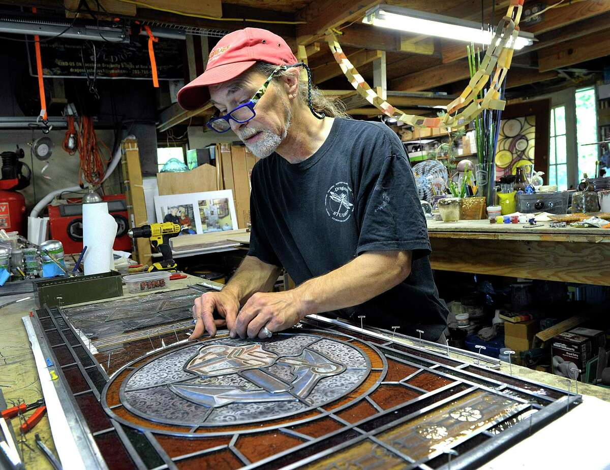 Markis Tomascak is restoring the stained glass windows of St John's Episcopal Church on in New Milford. Photo Tuesday, July 10, 2018.