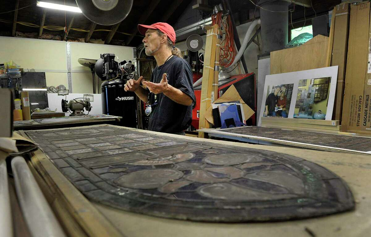 Markis Tomascak, working in his New Milford studio, is restoring the stained glass windows of St John's Episcopal Church on in New Milford. Photo Tuesday, July 10, 2018.
