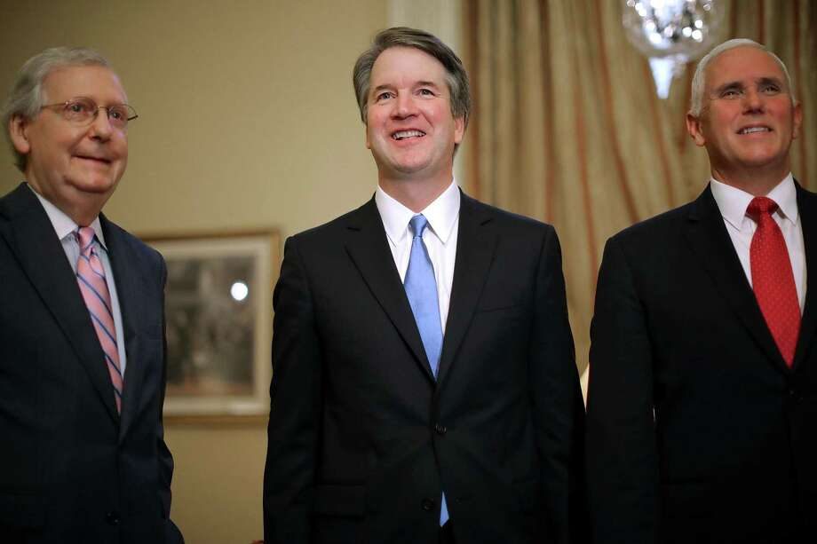 Senate Majority Leader Mitch McConnell, a Republican from Kentucky, from left, Brett Kavanaugh, U.S. Supreme Court associate justice nominee for U.S. President Donald Trump, and U.S. Vice President Mike Pence, stand during a meeting at the U.S. Capitol in Washington, D.C., U.S., on Tuesday, July 10, 2018. Senate Republicans are pledging a swift confirmation process that would put Kavanaugh on the bench before the new term opens Oct. 1, and there is little Democrats can do to stop them. Photo: Chip Somodevilla / Bloomberg / © 2018 Bloomberg Finance LP