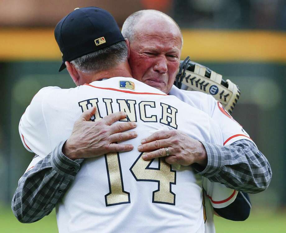 Former Houston Astros first base coach Rich Dauer embraces manager A.J. Hinch after throwing out the ceremonial first pitch during pregame ceremonies at the Astros home opener at Minute Maid Park on Monday, April 2, 2018, in Houston. Photo: Brett Coomer, Staff / Houston Chronicle / © 2018 Houston Chronicle