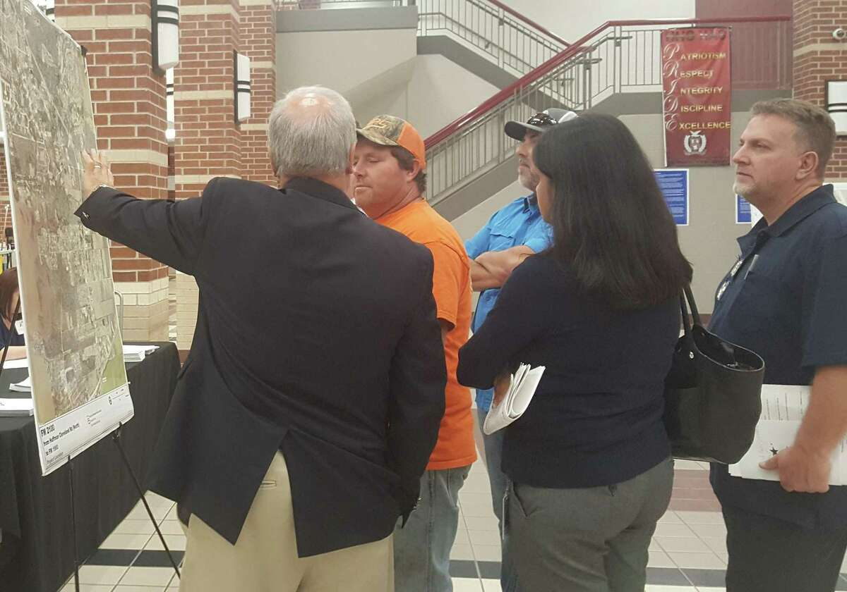 People from the community view and discuss plans for a proposed widening of FM 2100from Huffman-Cleveland Road N to FM 1960 during a public meeting held by TxDOT at Hargrave High School in Huffman Dec. 13.