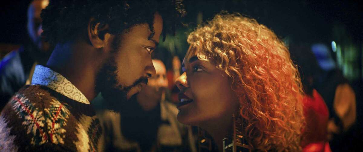 """Lakeith Stanfield, left, as Cassius Green and Tessa Thompson as Detroit star in """"Boots Riley's """"Sorry to Bother You."""""""