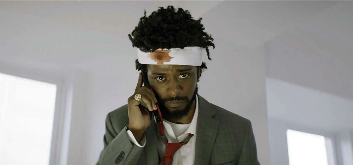 """""""Sorry to Bother You,"""" a sleeper hit, may be the most overtly anti-capitalist feature film made in America, says New York Times columnist Michelle Goldberg. This image released by Annapurna Pictures shows Lakeith Stanfield as Cassius Green in a scene from the film, """"Sorry To Bother You."""" (Annapurna Pictures via AP)"""