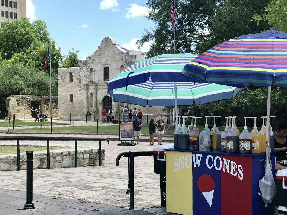 Some day Alamo Plaza will look entirely different, but on a sunny day last summer the venerable shrine continued to share space with snow cone stands, traffic and gaudy tourist traps.