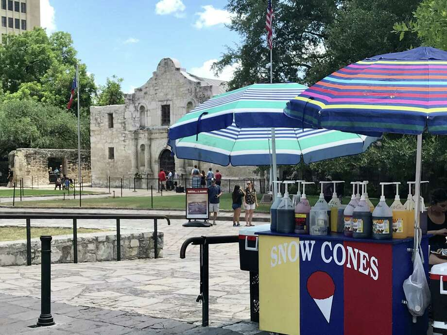 Some day Alamo Plaza will look entirely different, but on a sunny day last summer the venerable shrine continued to share space with snow cone stands, traffic and gaudy tourist traps. Photo: /Joe Holley /Houston Chronicle / Houston Chronicle