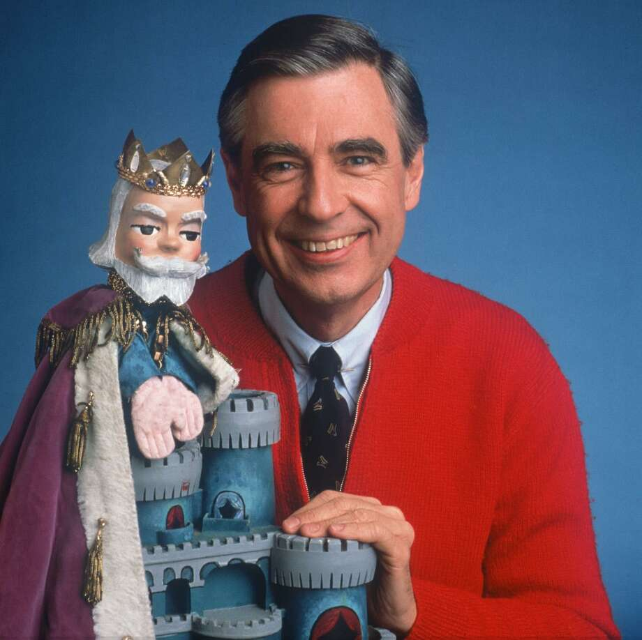 Fred Rogers had planned to be a minister, but his career detoured. Mister Rogers' Neighborhood premiered nationwide on Feb. 19, 1968, on PBS. Rogers is shown with one of his puppets on the show, King Friday. Photo: Unknown /PBS