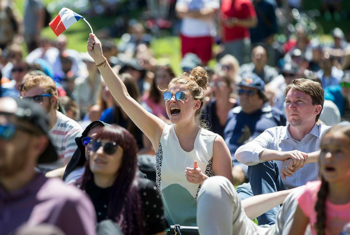 A France fan cheers as France and Belgium face off during the 2018 FIFA World Cup semi-finals watch party at Sue Bierman Park in San Francisco, Calif. Tuesday, July 10, 2018.