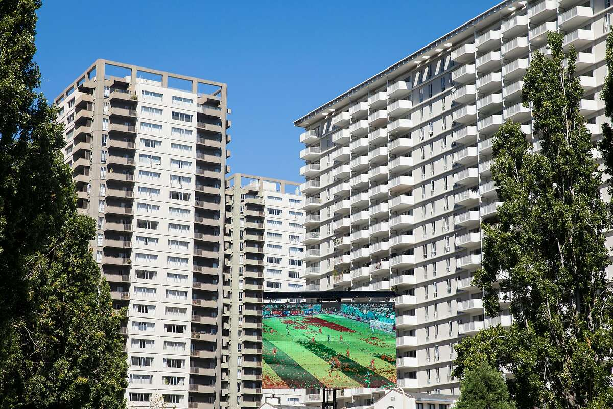 A large screen sits above Sue Bierman Park in San Francisco, Calif. Tuesday, July 10, 2018 during a watch party as France and Belgium face off during the 2018 FIFA World Cup semi-finals.