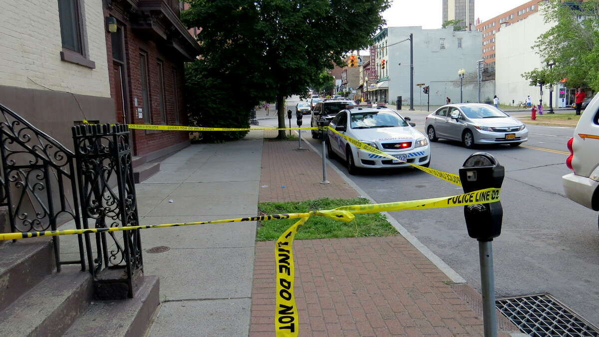 Albany police investigate the scene of where a baby apparently fell out of a window at Madison Avenue. (Tom Heffernan Sr. / Special to the Times Union)