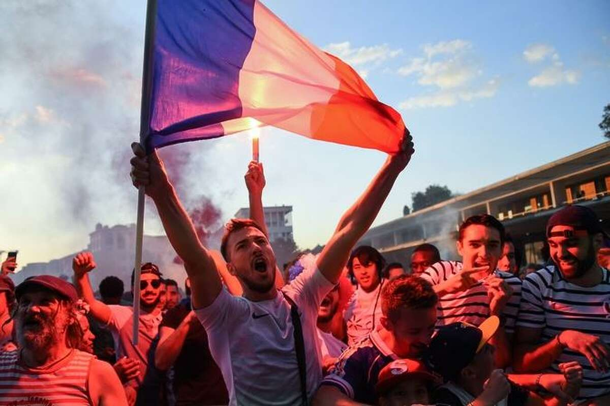 People celebrate France's first goal as they gather at a fan zone in Montpellier, southern France, on July 10, 2018 to watch the Russia 2018 World Cup semi-final football match between France and Belgium. / AFP PHOTO / SYLVAIN THOMASSYLVAIN THOMAS/AFP/Getty Images