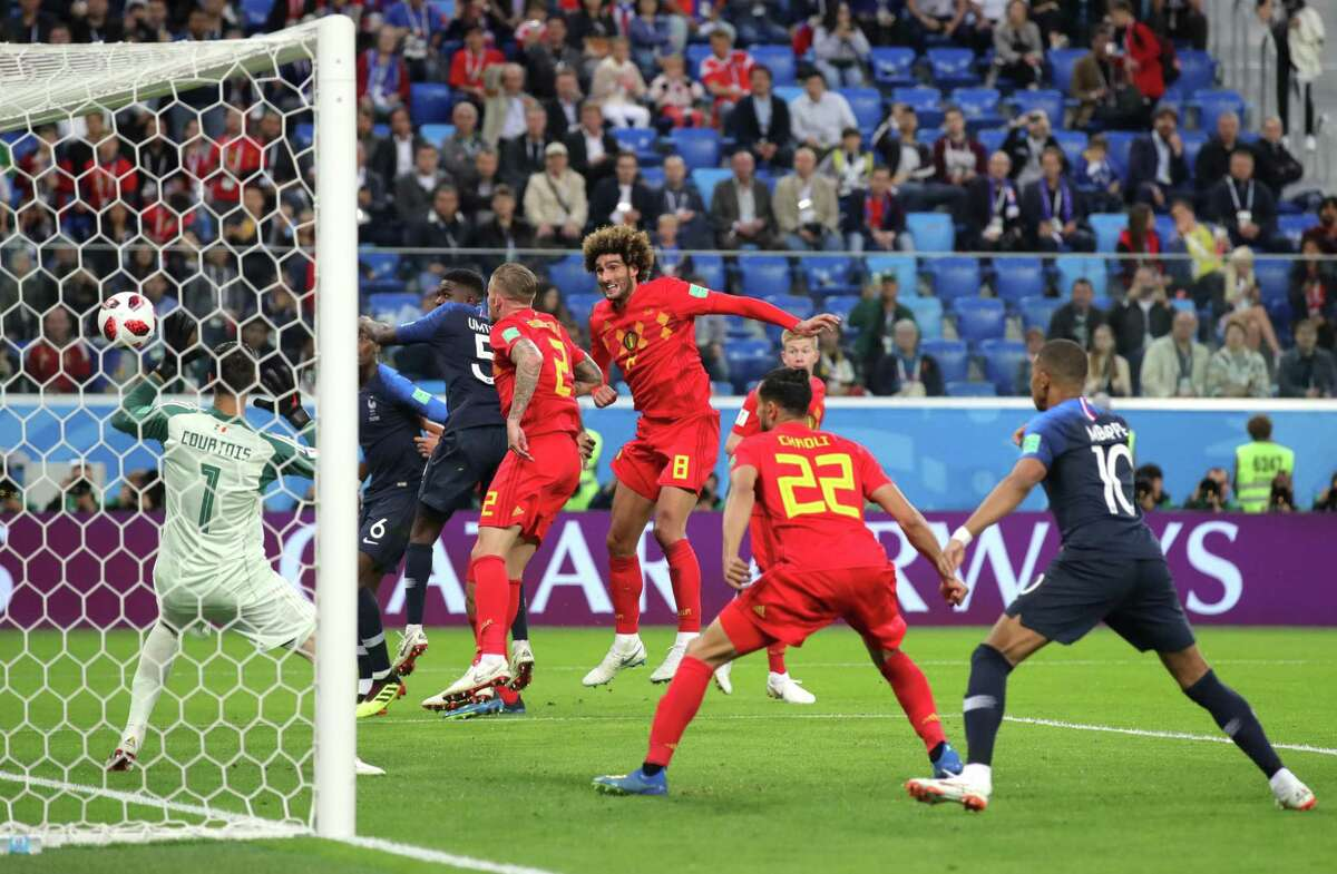 Samuel Umtiti of France scores his team's first goal during the 2018 FIFA World Cup Russia Semi Final match between Belgium and France at Saint Petersburg Stadium on July 10, 2018 in Saint Petersburg, Russia. (Photo by Alexander Hassenstein/Getty Images)