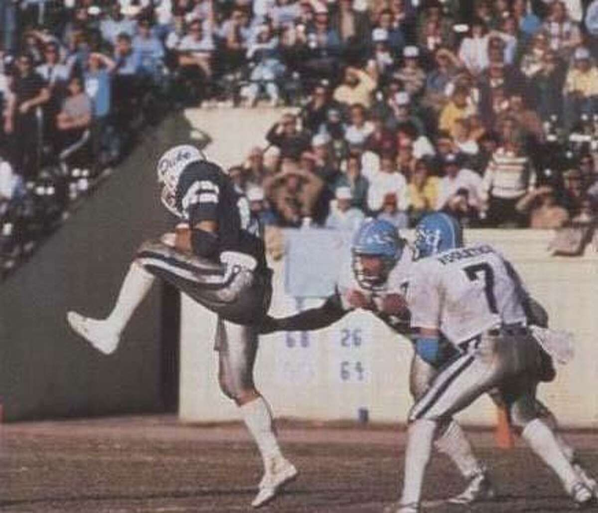New Canaan wide receiver coach Jason Cooper died unexpectedly on Saturday, July 7, 2018 at age 52. A former standout at New Canaan, Cooper played at Duke before a brief NFL career. Cooper is shown here catching a pass while at Duke.