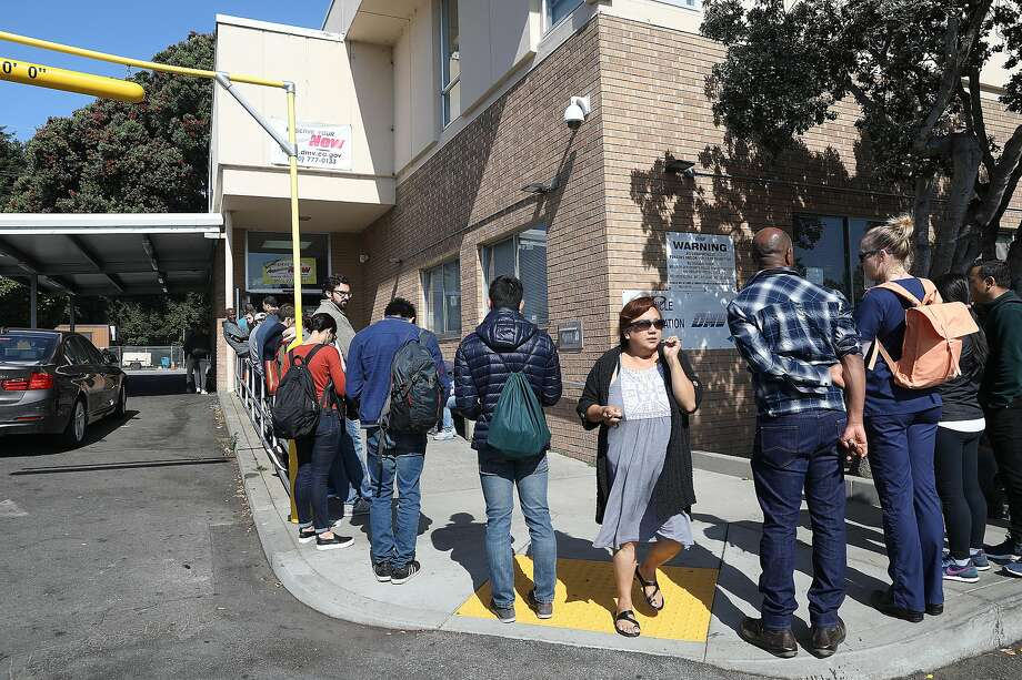 On Tuesday, an assembly budget committee and the Assembly Transportation Committee will hold a joint hearing to find solutions for the hours-long wait times at the DMV. (A line for the San Francisco office is shown here.) Photo: Liz Hafalia / The Chronicle