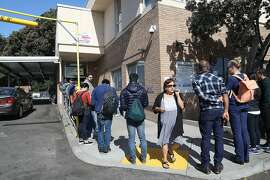 Line for the State Department of Motor Vehicles seen on Thursday, July 5, 2018 in San Francisco, Calif.  YoGov, an Oakland company, promises �expedited appointments� at a time when lines at the DMV are getting longer and appointments harder to schedule.