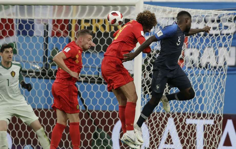 Samuel Umtiti (right) scores on a header off a corner kick. Belgium, the tournament's highest scoring team, was shut out. Photo: Petr David Josek / Associated Press / Copyright 2018 The Associated Press. All rights reserved