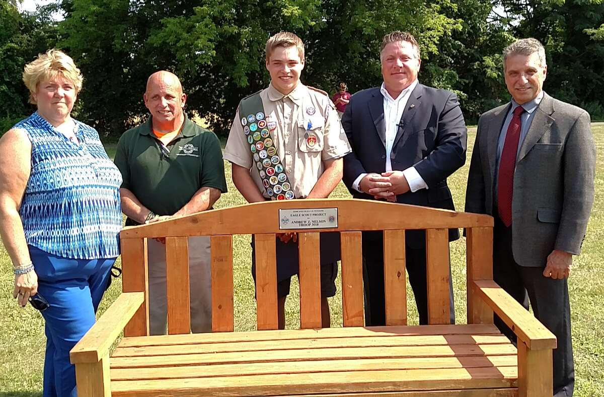 On July 3, Albany County Executive Dan McCoy recognized Andrew Nelson, who was a Colonie Central High School senior when he completed four benches for his final Eagle Scout project, made specifically for veterans to enjoy at Ann Lee Pond near the Shaker Heritage site. From left, Andrew's parents Wendy and Jeff Nelson, Andrew, McCoy and Albany County Legislature Minority Leader Frank Mauriello.