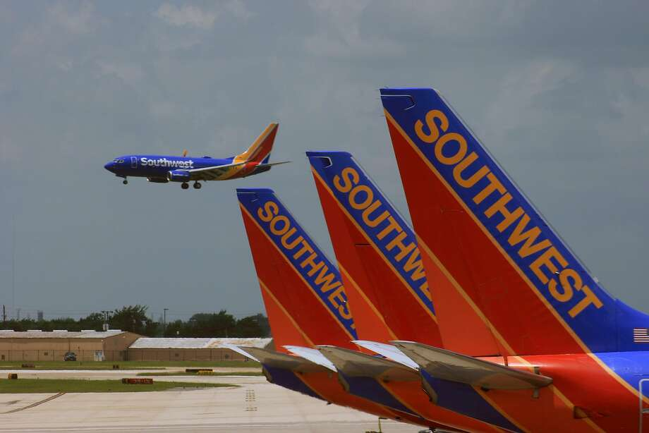 A Southwest Airlines Boeing 737 with the carrier's new paint job lands at Hobby Airport. The planes being prepared for departure from the international terminal sport the carrier's older paint scheme. Photo: Bill Montgomery, Houston Chronicle