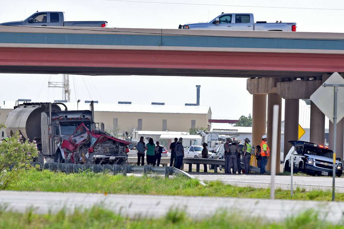 Texas Department of Public Safety personnel work the scene of a wreck on Interstate 20 underneath the FM1788 overpass July 10, 2018., James Durbin/Reporter-Telegram