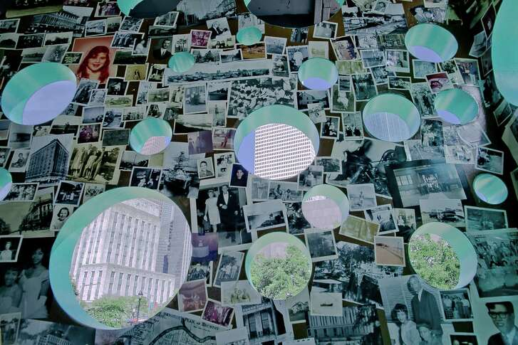 """The walls inside Havel Ruck Projects' """"Open House"""" immersive sculpture hold a collage of thousands of vintage photographs. The portholes cut in the exterior offer views of downtown and Sam Houston Park."""