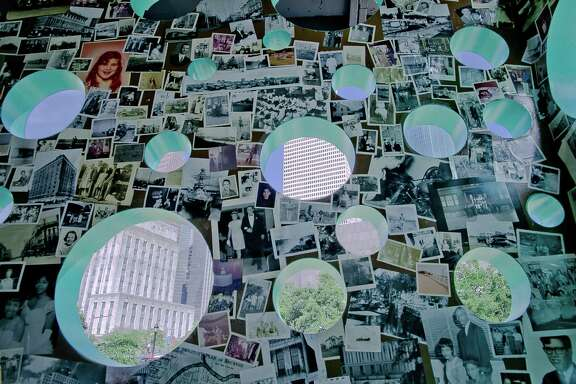 "The walls inside Havel Ruck Projects' ""Open House"" immersive sculpture hold a collage of thousands of vintage photographs. The portholes cut in the exterior offer views of downtown and Sam Houston Park."