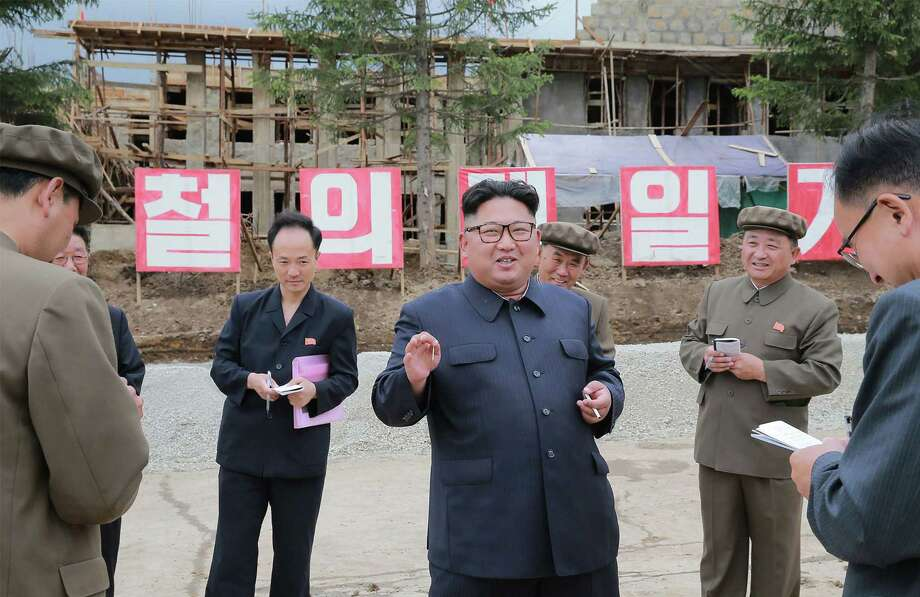 This undated picture released by North Korea's official Korean Central News Agency on July 10, 2018 via KNS shows North Korean leader Kim Jong Un (C) inspecting a construction site in Samjiyon County. Photo: KCNA VIA KNS, Contributor / AFP/Getty Images / AFP OR LICENSORS