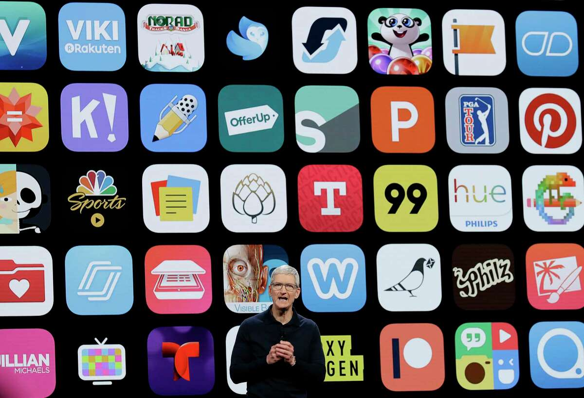 FILE - In this Monday, June 4, 2018 file photo, Apple CEO Tim Cook speaks during an announcement of new products at the Apple Worldwide Developers Conference in San Jose, Calif. Since its debut 10 years ago Tuesday, July 10, 2018, Apple?'s app store has unleashed new ways for us to work, play, and become lost in our screens. (AP Photo/Marcio Jose Sanchez, File)