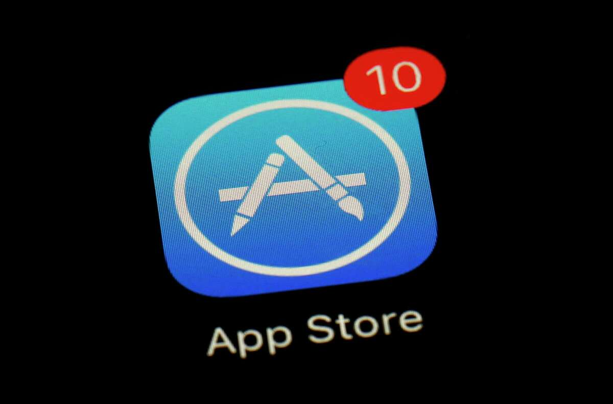 FILE - This March 19, 2018 file photo shows Apple's App Store app in Baltimore. Since its debut 10 years ago Tuesday, July 10, 2018, Apple?'s app store has unleashed new ways for us to work, play, and become lost in our screens. (AP Photo/Patrick Semansky, File)