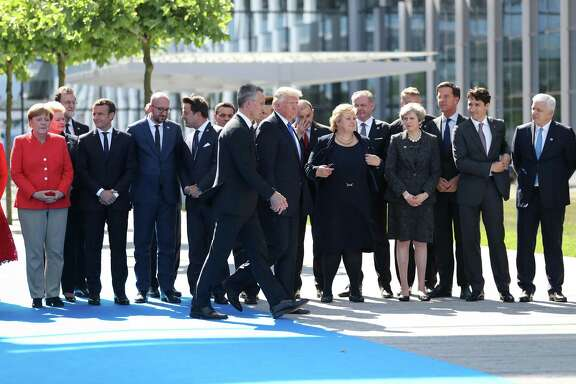 President Donald Trump (center) walks with Jens Stoltenberg, secretary general of the North Atlantic Treaty Organization, as world leaders gather for a group photograph during a summit at the NATO headquarters in Brussels on May 25, 2017. MUST CREDIT: Bloomberg photo by Jasper Juinen.