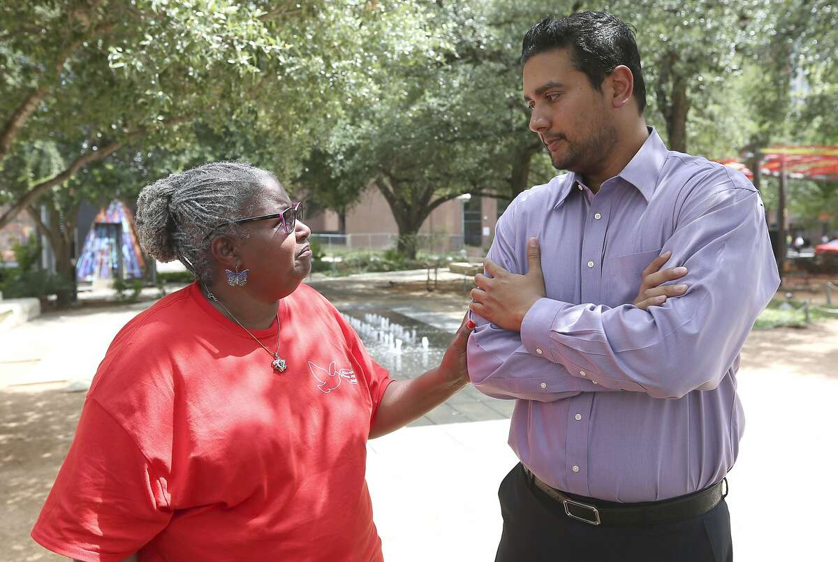 """Valerie Harris, left, talks with Mitesh Patel on Tuesday, July 10, 2018, in Main Plaza. Harris is the aunt of condemned killer Christopher Anthony Young who is scheduled to be executed July 17 for the 2004 murder of Patel's father, Hasmukh """"Hash"""" Patel."""