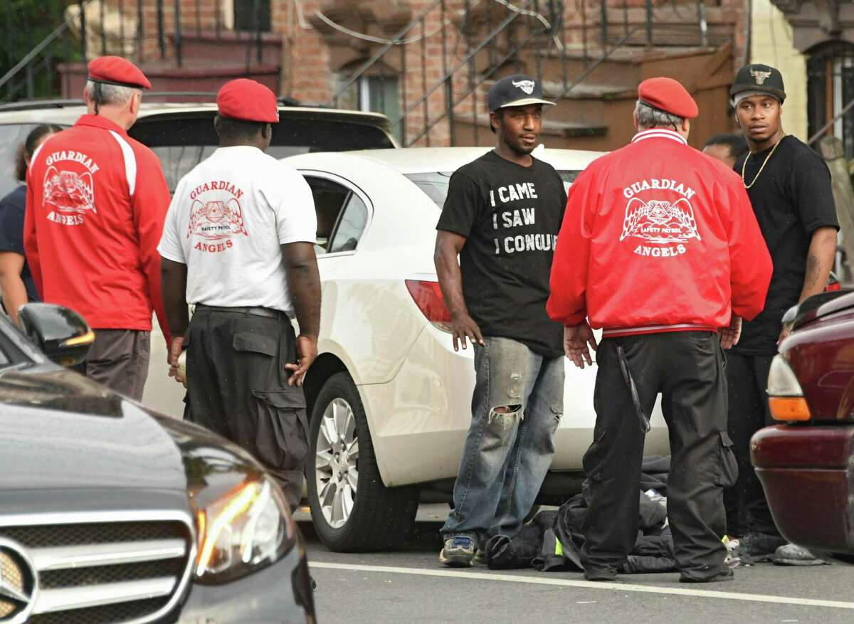 Guardian Angels including founder Curtis Sliwa settle a domestic altercation near the corner of Clinton and Lexington Avenues on Tuesday, July 10, 2018 in Albany, N.Y. (Lori Van Buren/Times Union)