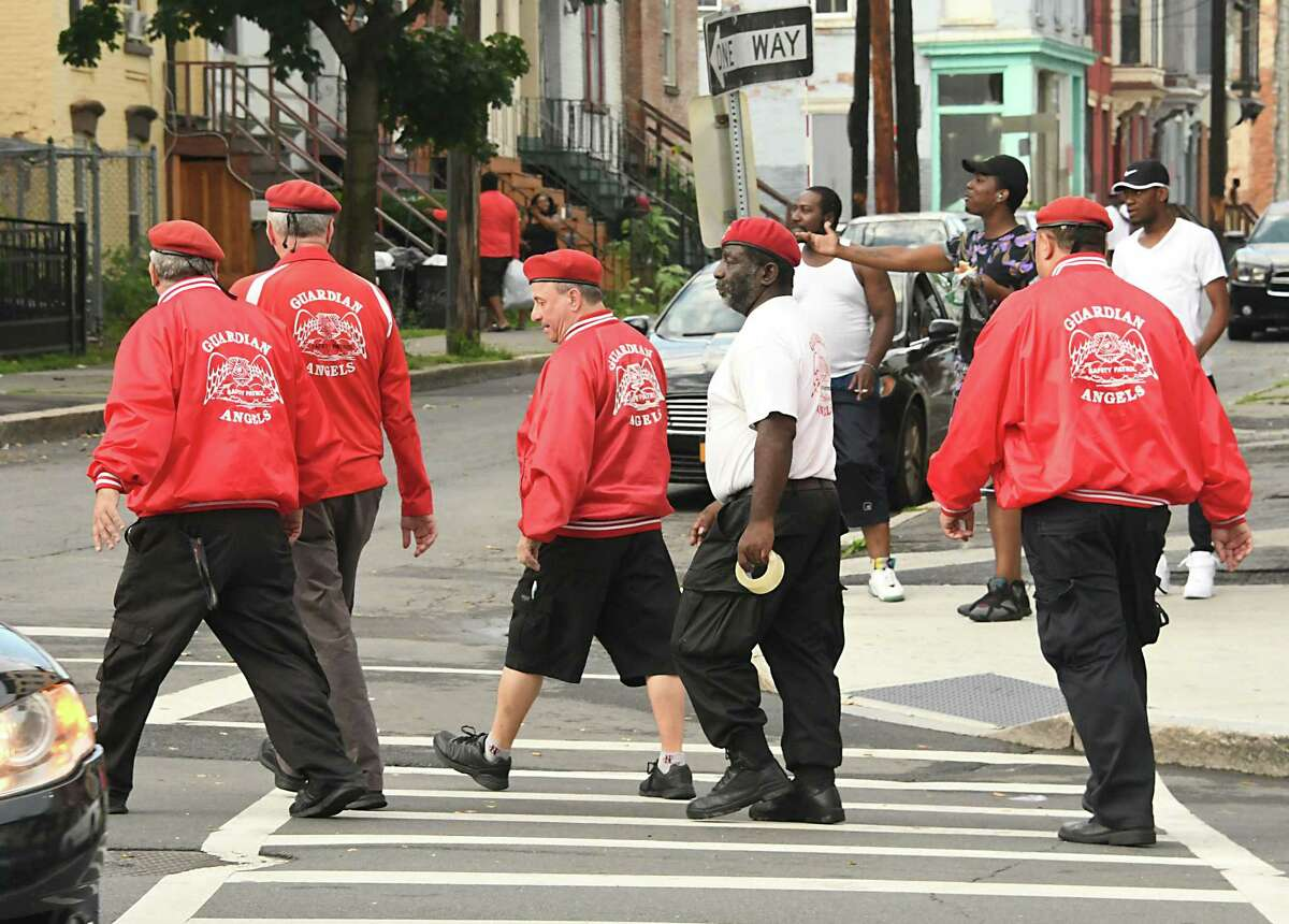 Guardian Angels including founder Curtis Sliwa, second from left, walk to the corner of Clinton and Lexington Avenues after settling a domestic altercation on Tuesday, July 10, 2018 in Albany, N.Y. (Lori Van Buren/Times Union)