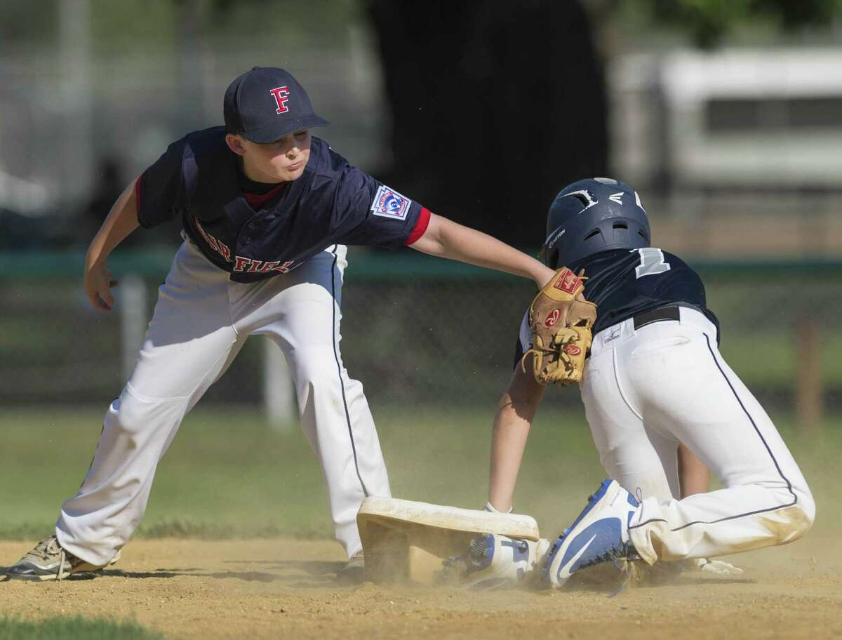 Westport's Nate Barrett slides safely into second as Fairfield National's Brendan Gagner can't get the tag down in time Tuesday.