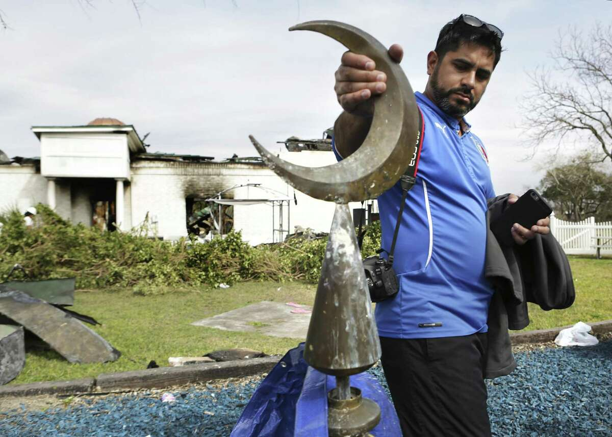Dr. Irfan Qureshi, a board member at the Victoria Islamic Center in Victoria, TX, inspects the damage to the crescent that was on top of a dome of the mosque, on Tuesday, Feb. 2, 2017.