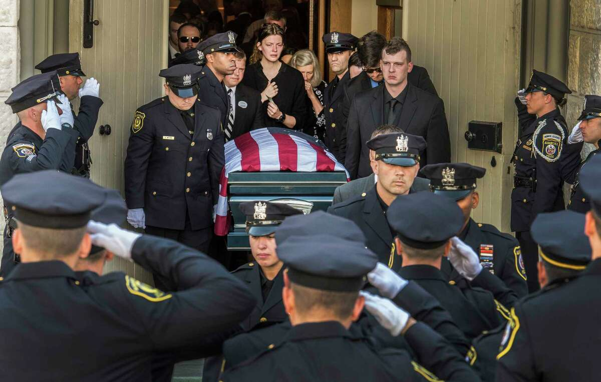 The casket carrying the remains of fallen Albany Police officer Dean Johnson leaves St. Mary's Church for the funeral service July 10, 2018 in Albany, N.Y. (Skip Dickstein/Times Union)
