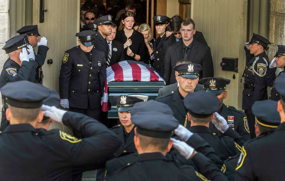 The casket carrying the remains of fallen Albany Police officer Dean Johnson leaves St. Mary's Church for the funeral service July 10, 2018 in Albany, N.Y.   (Skip Dickstein/Times Union) Photo: SKIP DICKSTEIN / 20044303A