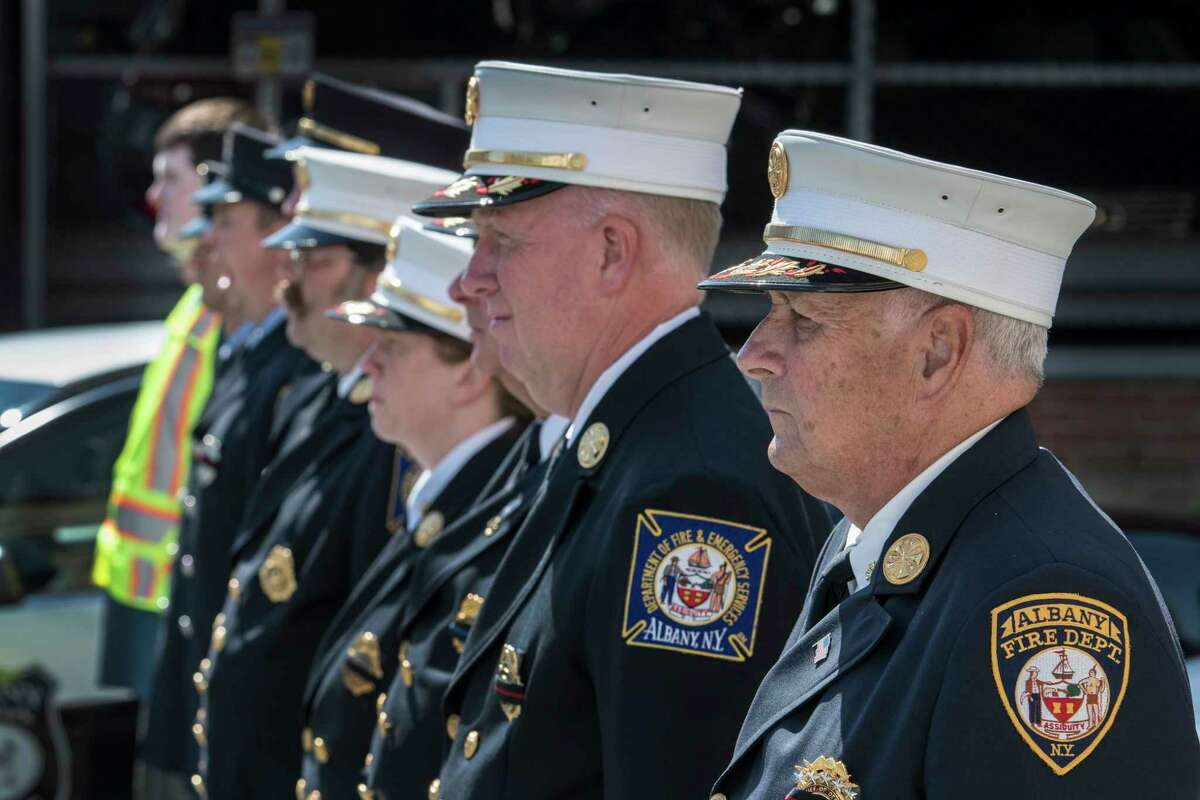 Members of the Albany Fire Department lead by Chief of Department Warren Abriel, right attend the funeral of fallen Albany Police officer Dean Johnson at St. Mary's Church July 10, 2018 in Albany, N.Y. (Skip Dickstein/Times Union)