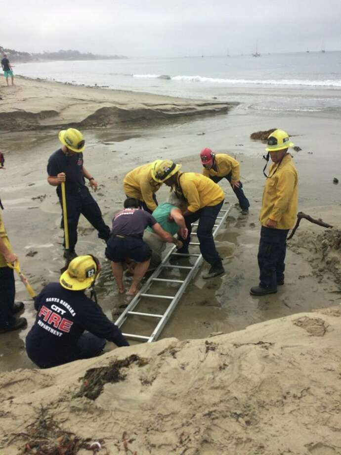 A woman was rescued after getting trapped up to her waist in sand on a central coast beach where Hurricane Fabio had created a quicksand effect, fire officials said. Click through the gallery for a roundup of extreme California weather. Photo: Santa Barbara CIty FIre Department