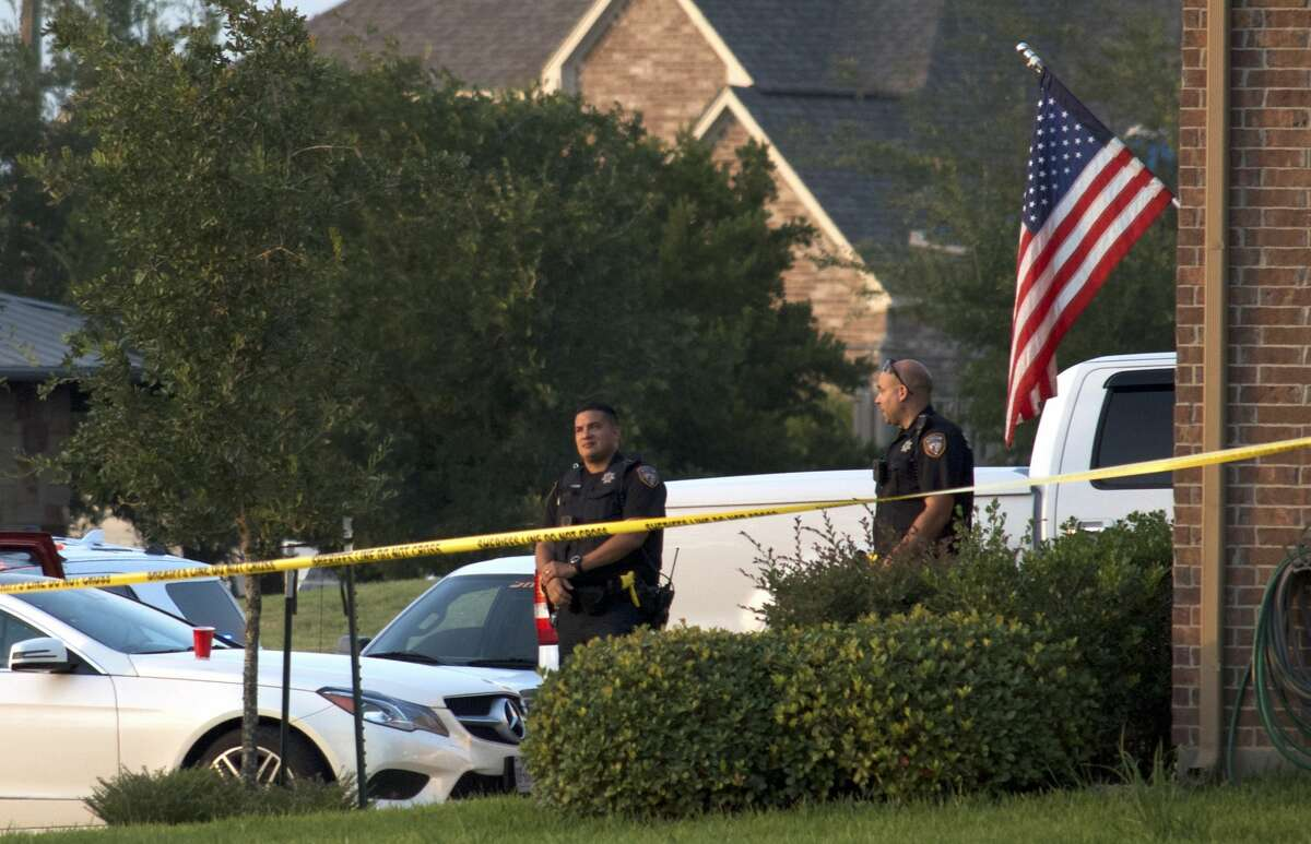 An American flag flies outside the Houston-area home where a toddler accidentally shot himself Tuesday, July 10, 2018.