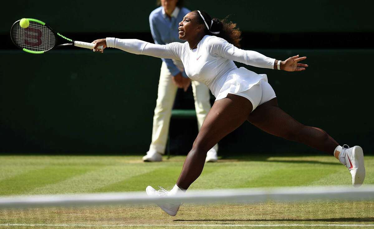US player Serena Williams returns against Italy's Camila Giorgi during their women's singles quarter-final match on the eighth day of the 2018 Wimbledon Championships at The All England Lawn Tennis Club in Wimbledon, southwest London, on July 10, 2018. / AFP PHOTO / Oli SCARFF / RESTRICTED TO EDITORIAL USEOLI SCARFF/AFP/Getty Images