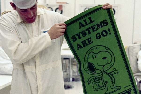 UNITED STATES - APRIL 16: Stafford, wearing his spacesuit, is being shown a pennant bearing the cartoon character Snoopy. The code name for the Apollo 10 Lunar Module was Snoopy and that of the Command Module, Charlie Brown. Apollo 10, with astronauts Stafford, John Young and Eugene Cernan aboard, was launched on 18th May 1969 on a lunar orbital mission, the dress rehearsal for the Apollo 11 Moon landing mission which took place two months later. (Photo by SSPL/Getty Images)
